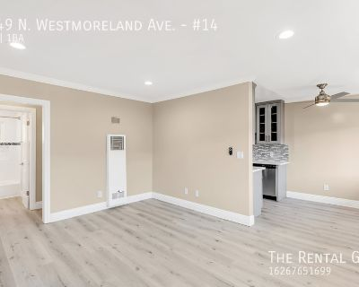 Bright Upper Unit | Newly Updated | Gated Parking Included |Great Virgil Village Location!