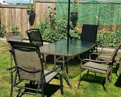 Patio table with 6 chairs and umbrella