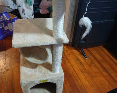 Cat tower with scratch board
