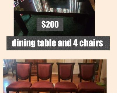 Dining room table glass top and 4 chairs