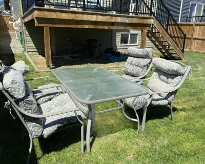 Patio table, 4 chairs & umbrella (not shown)