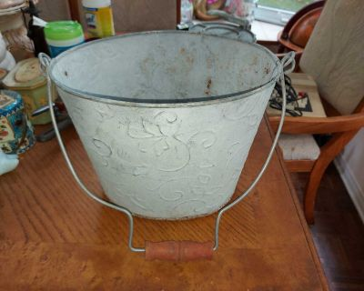 """Rustic oval galvanized tin metal bucket. Can be used as planter. Some rust inside. 10"""" (plus the handle) by 12"""" by 9"""""""