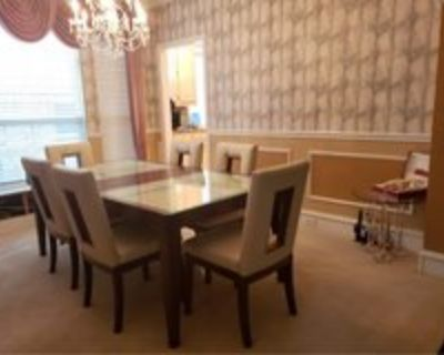 luxury dining table with 6 luxury chairs