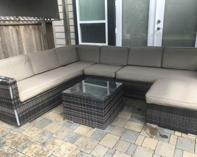 Patio furniture- sectional with coffee table.