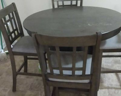 Dinner table with four chairs