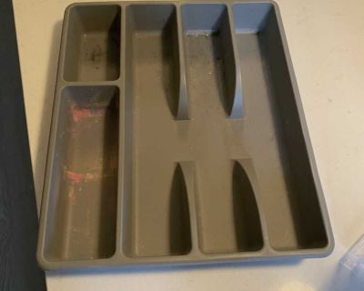 Grey plastic storage container for cutlery