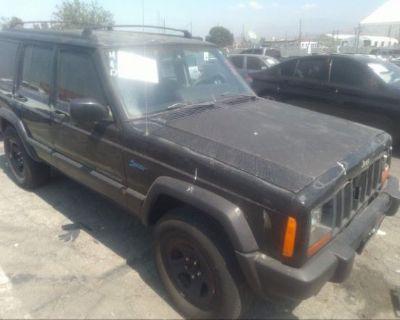 Salvage Black 1998 Jeep Cherokee