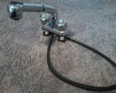 Used sink faucet with pullout sprayer