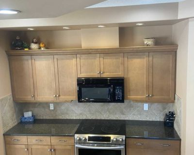 Kitchen cabinets, countertop, microwave
