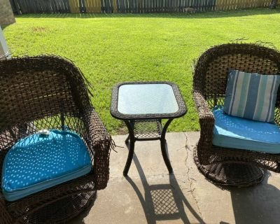 2 large outdoor swivel chairs with cushion, $20.00