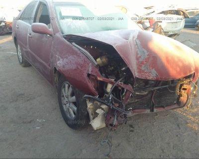 Salvage Maroon 2002 Toyota Camry