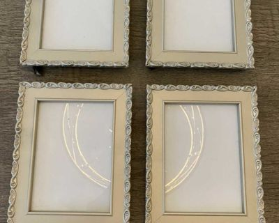 Set of 4 champagne picture frames. 9 1/4 X 7.5 . Holds 5x7 photo. $12 for all.