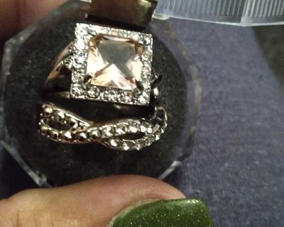 Square cut pink diamond with a looped diamond band