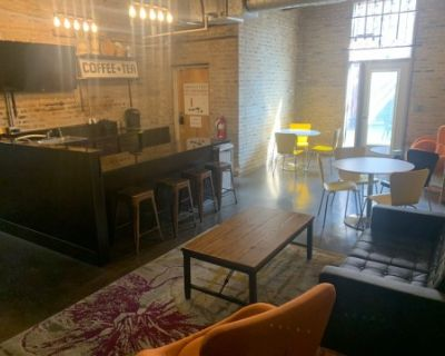 Industrial grunge cafe with high ceiling, Chicago, IL