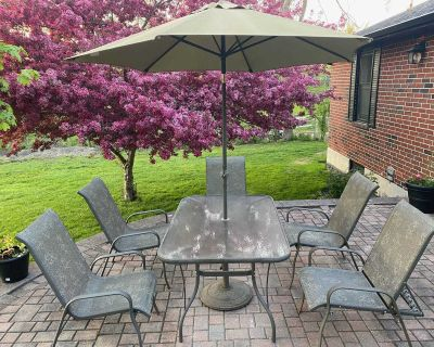 Patio set. Table, chairs and umbrella with stand