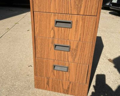 Filing cabinet, 4 drawer with wheels, approximately 15 wide x 28 tall x 18 deep