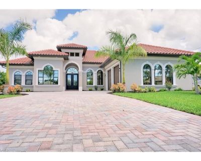 Dream House Waterfront with heated pool, Boat Dock, and jet ski platform. - Pelican