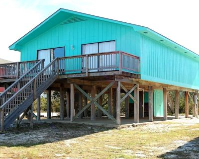 Andrews Cottage is a pet friendly Gulf Shores Beach House Rental with a pier! - Gulf Shores