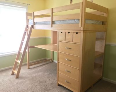 Children's bunk bed with a desk