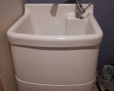 Used one piece laundry tub with faucet