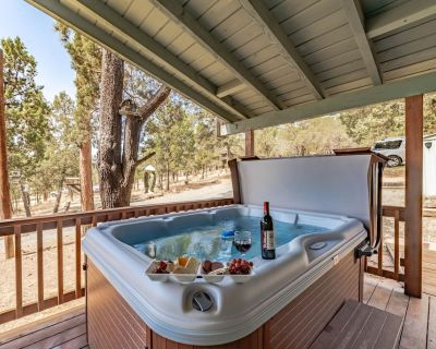 Tucked away on a quiet road amid towering pine trees, Wild Horse Retreat feels b - Alto