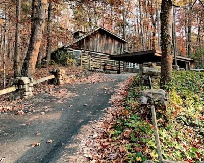 This historic cabin is nestled in the woods only minutes from town. - Pigeon Forge