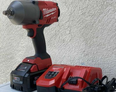 1/2 Milwaukee impact gun with rapid battery and charger