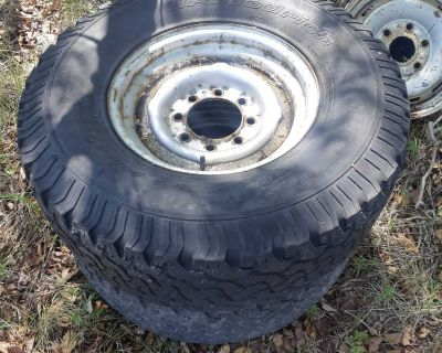 Pair (2) of 8 lug rims, 285/75r16 bfg tires. Tires are low on tread but still drive fine