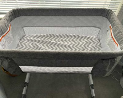 Delta bassinet with sheets.