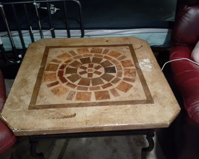 Two Mexican stone end tables