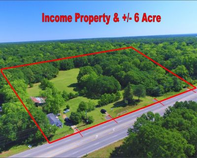 +/- 6 Acre Income property on high traffic Old Shell Rd.