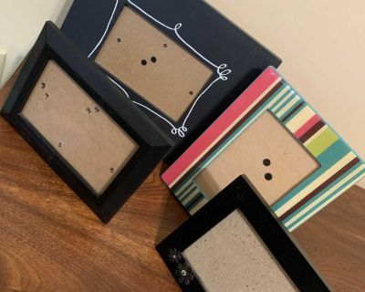 Four picture frames each hold 5-1/2 x 3-1/2 photos each has an easel. Large one can be written with chalk pen. Excellent condition