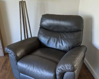Grey Faux Leather Recliner for pick up in Cooper's Crossing Airdrie