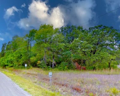This beautiful vacant lot is in the quiet waterfront town in Mabank