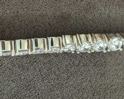 Sterling Silver tennis bracelet (retails $500)