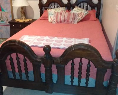 Queen-size solid wood bed frame with Sealy double pillow top mattress and box springs