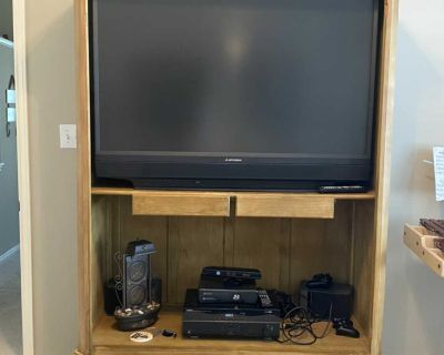 Antique armoire and TV