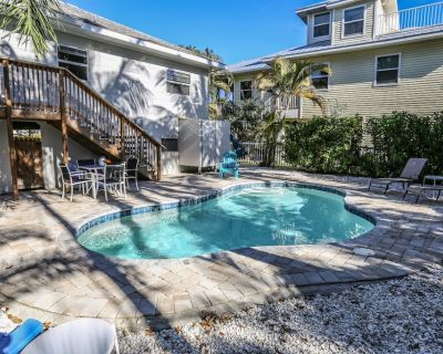 Welcome to 126 Coconut Drive, a unique, old Florida, comfortable, and private 3 bedroom, 2 bath single family pool home. - Mid Island