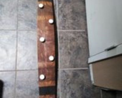 Coat rack made from a wine barrel