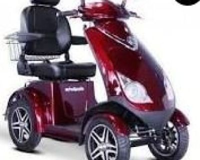 Scooter Heavy duty, 4 wheel, 18mph, 42 mile charge, like new, new tire, new battery, about 300 miles