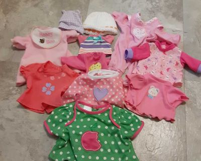Assorted sized baby doll clothes