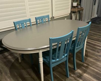 75x44 refinished table with 4 wooden chairs