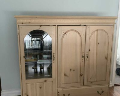 Armoire with pull-out TV stand