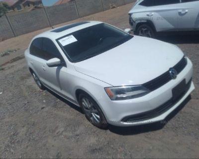 Salvage White 2012 Volkswagen Jetta Sedan