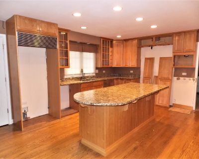 Maple Kitchen With Island And Granite Counter Tops