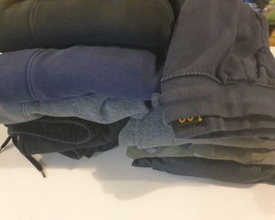 9 pairs of boys used size xl joggers