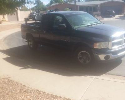 2005 dodge ram with brand new mobility lift in back of truck