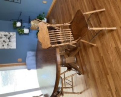 Solid oak table with 5 chars and light blue tablecloth. $300