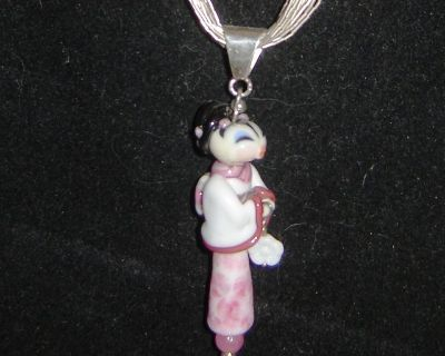 Unique Japanese Pendant with 30 inch 10 strand Sterling silver necklace.