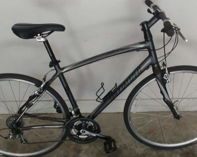 Specialized Sirrus Expert Light weight 27 speed Road bike with Flat bars